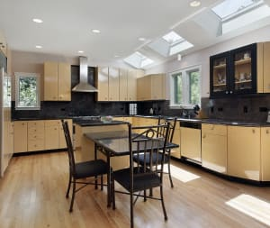 light brown hardwood flooring in a kitchen with table