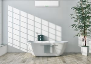 gray laminate flooring in a bathroom with a white tub
