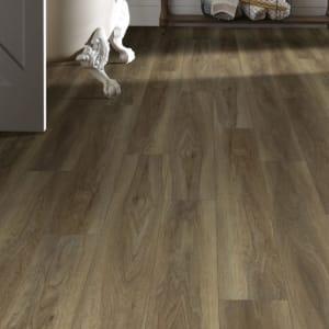 brown, wood-look luxury vinyl plank flooring (LVP) in bathroom with claw-foot tub