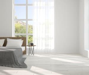 light gray luxury vinyl plank flooring (LVP) in a bedroom