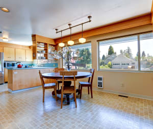 light brown tile flooring in kitchen with table and chairs