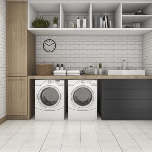 white tile flooring in laundry room with washer and dryer