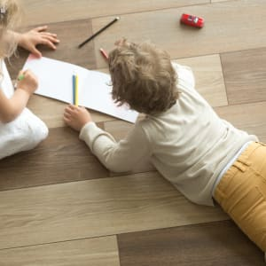 brown wide plank hardwood flooring with children playing