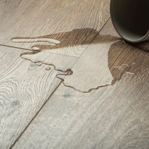 brown laminate flooring with water spilled