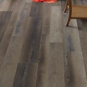 brown, wood-look luxury vinyl plank flooring (LVP) in a living room