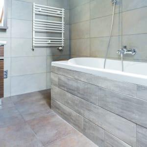 gray stone-look porcelain tile flooring in a bathroom